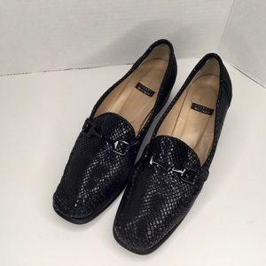 Stuart Weizmann black leather loafers.